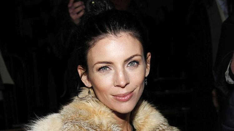 "Liberty Ross is seen at the Fall 2013 Alexander Wang Runway Show, on Saturday, Feb.  9, 2013 in New York. Ross says she's lying low in the wake of her very public split from husband, director Rupert Sanders. Ross filed for divorce in January, five months after news broke that Sanders had an affair with Kristen Stewart. Sanders directed both Stewart and Ross in ""Snow White and the Huntsman.""  Ross also walked the runway for the Alexander Wang Spring 2013 collection on Sept. 8, 2012. (Photo by Amy Sussman/Invision/AP)"