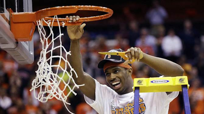 Syracuse forward C.J. Fair (5) cuts down the net following their 55-39 win over Marquette in the East Regional final in the NCAA men's college basketball tournament, Saturday, March 30, 2013, in Washington. (AP Photo/Pablo Martinez Monsivais)