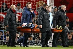 Norwich City's Snodgrass is stretchered off during their English League Cup fourth round soccer match against Manchester United in Manchester
