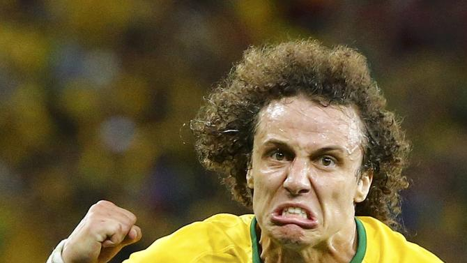 Brazil's Luiz celebrates after scoring a goal against Colombia during the 2014 World Cup quarter-finals soccer match at the Castelao arena in Fortaleza