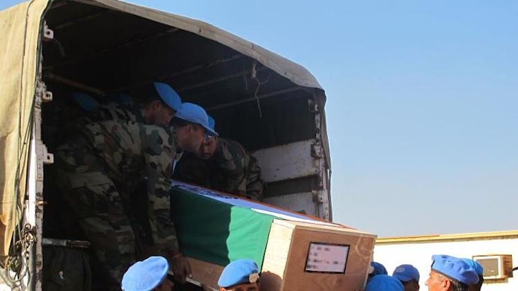 Handout photo taken on December 20, 2013 released by UN Mission in South Sudan (UNMISS) shows the remains of two UN soldiers from the Indian Battalion being transported to Juba for a memorial ceremony