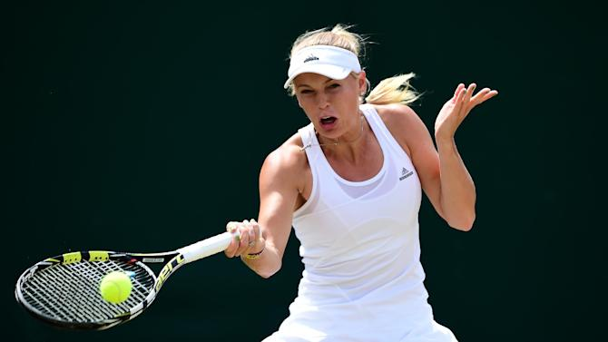 Denmark's Caroline Wozniacki returns to Czech Republic's Barbora Zahlavova Strycova during their women's singles fourth round match on day seven of the 2014 Wimbledon Championships in Wimbledon, southwest London, on June 30, 2014