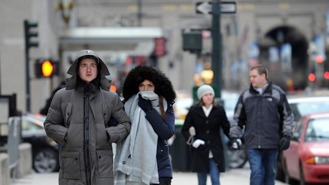 "Benedikt Vom Orde and Julia Felte, tourists from Essen, Germany, walk along Park Avenue in New York during a bitter cold spell, Saturday, Feb. 13, 2016. Bitter temperatures and biting winds had much of the northeastern United States bundling up for the some of the worst cold of the winter — a snap so bad it forced an ice festival in Central Park to cancel and caused an Interstate pileup that killed three. ""These temperatures can be life threatening — especially for seniors, infants and people with medical conditions,"" New York City Mayor Bill de Blasio said. Stay indoors and take care of each other, he counseled. (AP Photo/Diane Bondareff)"