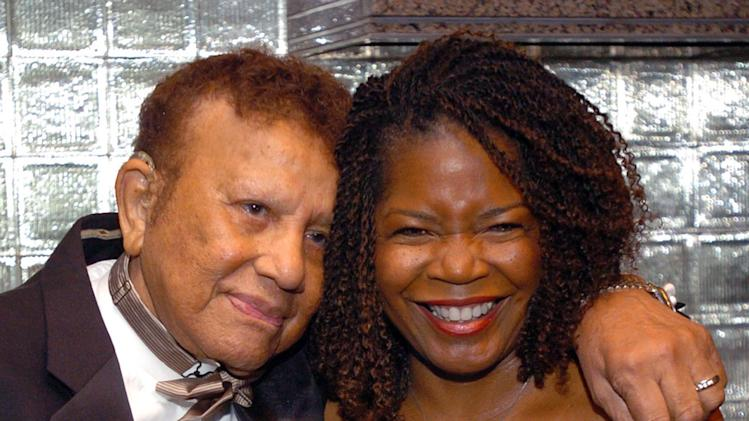 """FILE- In this Nov. 3, 2004 file photo, Harold """"Hal"""" Jackson and wife Debi share a moment before celebrating Jackson's 65 years of broadcasting at a benefit for the Youth Development Foundation, at the Rainbow Room in New York. Jackson, who was the first African-American voice on network radio, died Wednesday, May 23, 2012. He was in his late 90s.  (AP Photo/Gina Gayle, File)"""