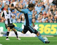 Alessandro Del Piero (C) of Sydney FC has a strike against Newcastle Jets during their A-League match in Sydney on October 13, 2012. Newcastle beat Sydney 3-2. Sydney are struggling to reverse a string of poor results despite boasting the Italian star forward