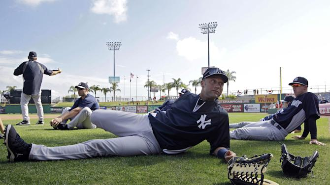 "New York Yankees shortstop Derek Jeter stretches before a spring training baseball game against the Philadelphia Phillies in Clearwater, Fla., Tuesday, March 19, 2013.  Jeter says he was removed from Tuesday's lineup for ""precautionary"" reasons because his surgically repaired left ankle feels ""stiff.""(AP Photo/Kathy Willens)"