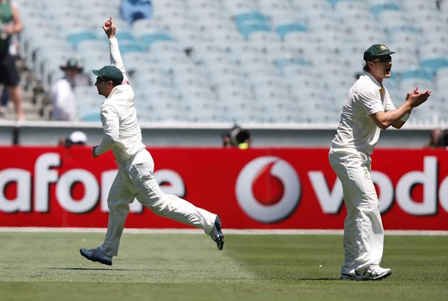 Phil Hughes (L) of Australia celebrates his catch to dismiss Prasanna Jayawardene of Sri Lanka off the bowling of Mitchell Johnson during day one of the Second Test match between Australia and Sri Lan