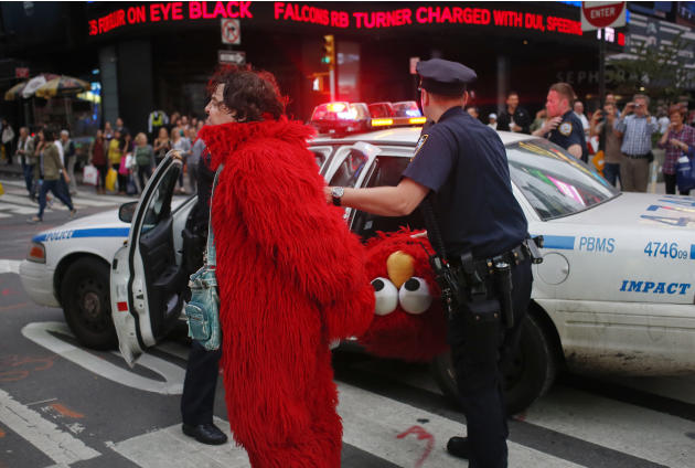 A man, dressed as the Muppet character Elmo, is arrested in New York's Times Square