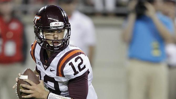 FILE- In this Sept. 6, 2014, file photo, Virginia Tech quarterback Michael Brewer rolls out against Ohio State during an NCAA college football game in Columbus, Ohio. Virginia Tech's loss to East Carolina made the high of winning the previous week at Ohio State a distant memory, Brewer said, and brought back into focus the Hokies' goal of playing well when they begin Atlantic Coast Conference play on Saturday against Georgia Tech