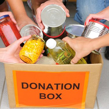 Hands-putting-food-in-donation-box_web