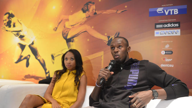 Jamaican athlete Usain Bolt, right, and US athlete Allyson Felix take part in a press conference on the eve of the IAAF (International Association of Athletics Federations) Athlete of the Year Award marking the centenary of IAAF in Barcelona, Friday, Nov. 23, 2012.(AP Photo/Manu Fernandez)