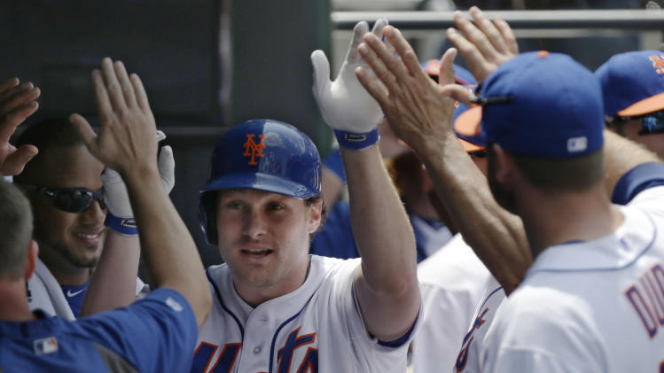 Teammates congratulate New York Mets' Daniel Murphy (28) after he hit a second-inning solo home run off Miami Marlins starting pitcher Tom Koehler in a baseball game in New York, Sunday, June 9, 2013. (AP Photo/Kathy Willens)