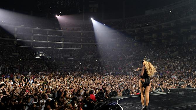 """IMAGE DISTRIBUTED FOR PARKWOOD ENTERTAINMENT - Singer Beyonce performs on her """"Mrs. Carter Show World Tour 2013"""" at Staples Center on Monday, July 1, 2013, in Los Angeles. Beyonce is wearing a custom hand beaded one-piece by Givenchey. (Photo by Frank Micelotta/Invision for Parkwood Entertainment/AP Images)"""