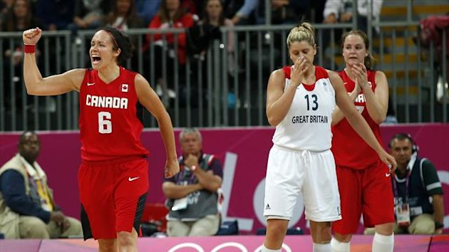 Canada's Shona Thorburn (L) celebrates victory against Great Britain after their women's preliminary round Group B basketball match at the Basketball Arena during the London 2012 Olympic Games (Reuters)