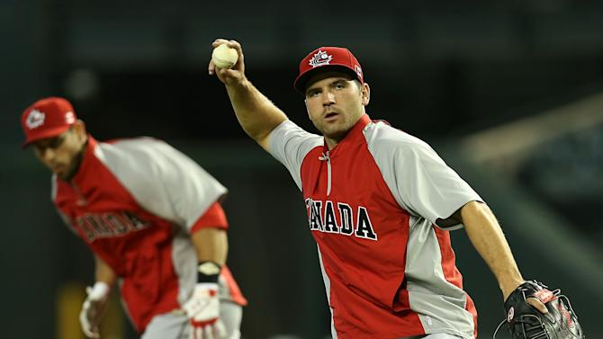 Infielder Joey Votto #19 of Canada warms up during batting practice before the World Baseball Classic First Round Group D game against Italy at Chase Field on March 8, 2013 in Phoenix, Arizona. (Photo by Christian Petersen/Getty Images)