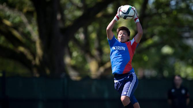 Japan goalkeeper Ayumi Kaihori makes a save during a practice session in Vancouver, British Columbia, Canada, on Saturday, July 4, 2015. Japan and the United States are scheduled to play in the final of the FIFA Women's World Cup soccer tournament on Sunday in Vancouver. (Darryl Dyck/The Canadian Press via AP) MANDATORY CREDIT