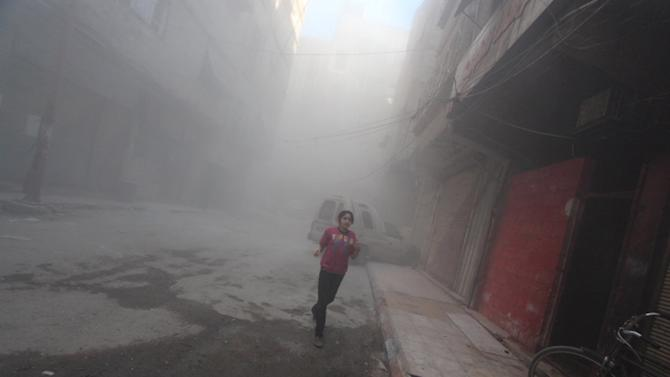 A girl runs down a street after what activists said was shelling by forces loyal to Syria's President Assad near the Syrian Arab Red Crescent center in the Douma neighborhood of Damascus