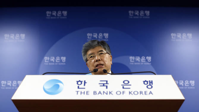A governor of the Bank of Korea Kim Choong-Soo answers reporter's question during a press conference on the benchmark interest rate at the bank's headquarters in Seoul, South Korea, Thursday, May 9, 2013. South Korea's central bank on Thursday cut its benchmark interest rate for first time in seven months, a surprise move apparently meant to counter the weakness of the yen. (AP Photo/Lee Jin-man)
