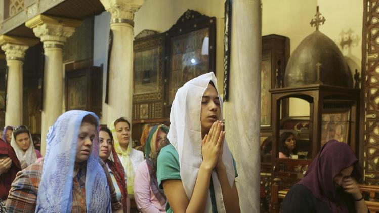 Copt Christians attend a church service during Holy Easter week in central Cairo