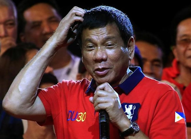 Philippine presidential candidate and Davao city mayor Rodrigo 'Digong' Duterte gestures during a