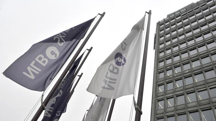 Flags with the logo of NLB bank flutter next to an office building in Ljubljana