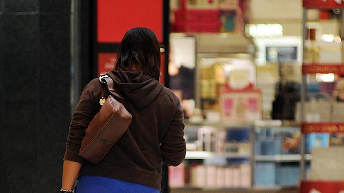 A Black Friday shopper carries purchases at Northpark Mall in Ridgeland, Miss., on Friday, Nov. 25, 2011. (AP Photo/The Clarion-Ledger, Vickie D. King) NO SALES