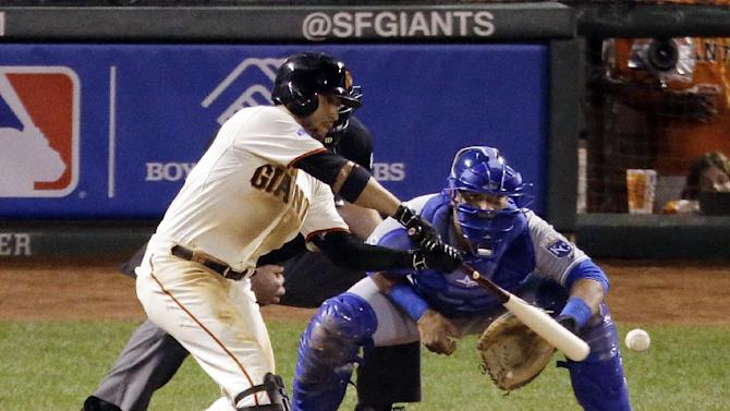 San Francisco Giants' Gregor Blanco hits a single during the sixth inning of Game 4 of baseball's World Series against the Kansas City Royals on Saturday, Oct. 25, 2014, in San Francisco. (AP Photo/Charlie Riedel)
