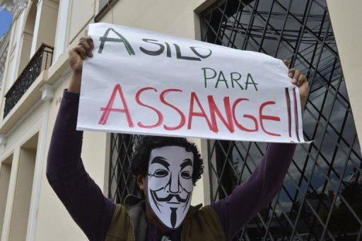 <p>An activist participates in a demonstration in support of WikiLeaks founder Julian Assange political asylum in front of the Foreign Ministry in Quito in June 2012. Assange, 41, took refuge at Ecuador's embassy in London on June 19 to avoid extradition to Sweden, where the Australian national faces police questioning over sexual assault allegations.</p>