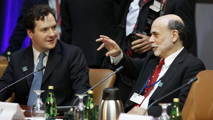 Federal Reserve Chairman Ben Bernanke, right, talks with British Chancellor of the Exchequer George Osborne during a G-20 finance ministers and central bank governors meeting, Friday, April 20, 2012, at the IMF and World Bank Group Spring Meetings in Washington. (AP Photo/Charles Dharapak)