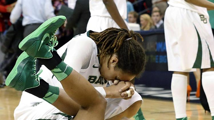 Baylor 's Brittney Griner, top, and guard Odyssey Sims, bottom, react after losing to Louisville in a regional semifinal game in the women's NCAA college basketball tournament in Oklahoma City, Sunday, March 31, 2013. Louisville won 82-81. (AP Photo/Sue Ogrocki)