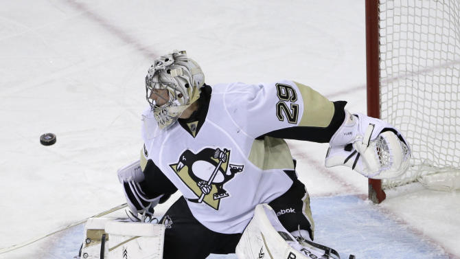 Pittsburgh Penguins goalie Marc-Andre Fleury (29) makes a save during the first period of Game 6 of a second-round NHL playoff hockey series against the New York Rangers, Sunday, May 11, 2014, in New York