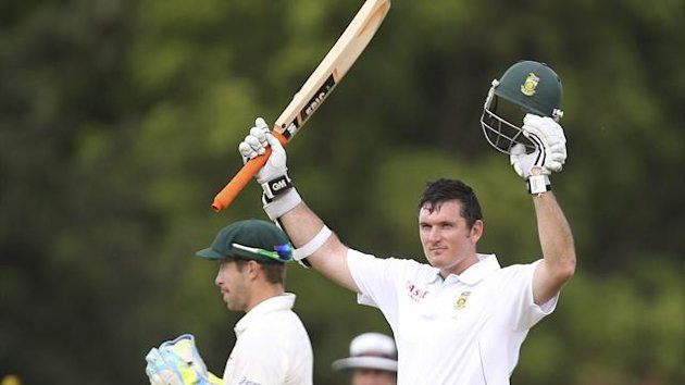 South Africa&#39;s Graeme Smith (R) celebrates reaching his century against Australia during their second cricket test match at the Adelaide cricket ground