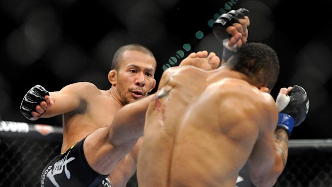 Ivan Menjivar, left, kicks Mike Easton, during their UFC 148 bantamweight fight at the MGM Grand Garden Arena, Saturday, July 7, 2012, in Las  Vegas. Easton won the bout by unanimous decision. (AP Photo/David Becker)