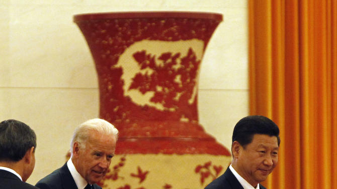 U.S. Vice President Joseph Biden, second from left, and Chinese Vice President Xi Jinping, right, walk to a welcome ceremony at the Great Hall of the People in Beijing, China, Thursday, Aug. 18, 2011. (AP Photo/Ng Han Guan)