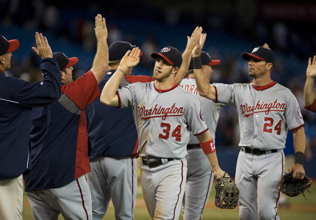 Washington Nationals' Bryce Harper (34) celebrates a 4-2 win over the Toronto Blue Jays with his team after an interleague baseball game in Toronto, Tuesday, June 12, 2012. (AP Photo/The Canadian Press, Aaron Vincent Elkaim)