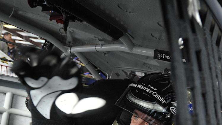 Driver Denny Hamlin sits in his car as he prepares for practice Sunday's NASCAR Sprint Cup series auto race at the Talladega Superspeedway in Talladega, Ala., Friday, May 3, 2013. Hamlin has been cleared by NASCAR to drive this week at Talladega following an injury he suffered at California. (AP Photo/Rainier Ehrhardt)