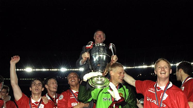 Alex Ferguson celebrates with Manchester United players and the European Cup