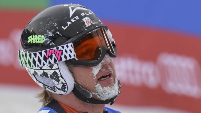 United States' Andrew Weibrecht has is face covered with snow after falling at the men's downhill  at the Alpine skiing world championships in Schladming, Austria, Saturday, Feb. 9, 2013. (AP Photo/Kerstin Joensson)