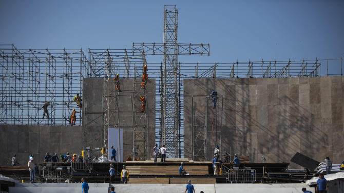 Workers build a stage in preparation for Pope Francis' visit for World Youth Day events along Copacabana beach in Rio de Janeiro, Brazil, Tuesday, July 16, 2013. Pope Francis will travel to Brazil and participate in World Youth Day events from July 22-28. (AP Photo/Felipe Dana)
