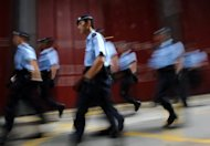 File photo shows police in Hong Kong. Hong Kong police said Wednesday they had arrested a man suspected of an attack on a Japanese couple which prompted Tokyo to warn its 22,000 citizens in the city to avoid going out at night