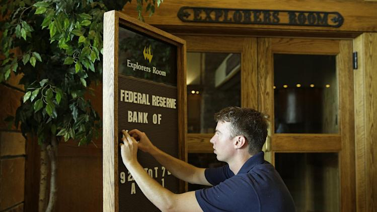 Tyler Lovelady puts letters on a sign in preparation for the Jackson Hole Economic Policy Symposium at the Jackson Lake Lodge in Grand Teton National Park near Jackson, Wyo. Thursday, Aug. 21, 2014. The Federal Reserve Bank of Kansas City is holding the Jackson Hole Economic Policy Symposium at the hotel. (AP Photo/John Locher)