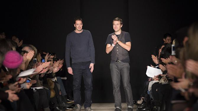 Designers Marcus Wainwright, left, and David Neville greet the crowd after the presentation of the Rag & Bone Fall 2013 fashion collection during Fashion Week, Friday, Feb. 8, 2013, in New York. (AP Photo/John Minchillo)