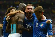 WARSAW, POLAND - JUNE 28:  Mario Balotelli (2nd L) of Italy celebrates with team-mates Claudio Marchisio (R) and Daniele De Rossi (2nd R) after scoring his team's second goal during the UEFA EURO 2012 semi final match between Germany and Italy at the National Stadium on June 28, 2012 in Warsaw, Poland.  (Photo by Shaun Botterill/Getty Images)