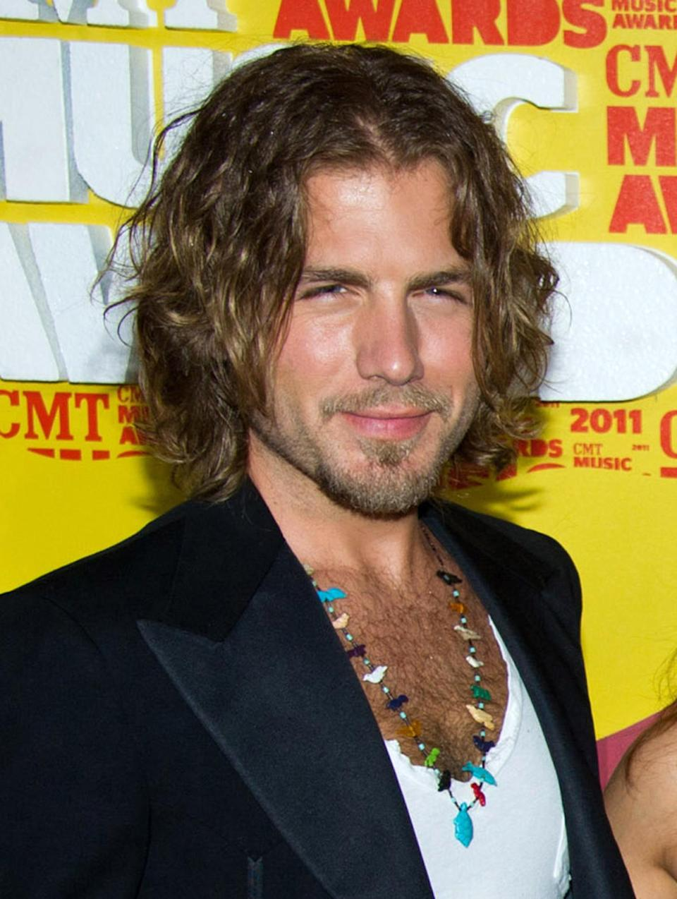 FILE - In this June 8, 2011 file photo, Tom Gossin of the band Gloriana arrives at the 2011 CMT Music Awards in Nashville, Tenn. Gossin is engaged to long-time girlfriend Jamie Moffett. He proposed on March 1.  (AP Photo/Charles Sykes, file)