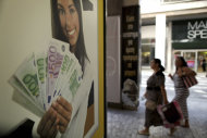 <p>               Pedestrians walk outside a pawn shop offering money for gold,  in Athens, on Monday, Aug. 20, 2012.  Greece's finance officials are seeking to finalize euro 11.5 billion in spending cuts necessary for it to continue receiving the international funding that is protecting it from bankruptcy. (AP Photo/Petros Giannakouris)