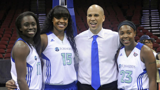 "Newark Mayor Cory Booker poses with New York Liberty WNBA basketball players Essence Carson, left, Kia Vaughn (15) and Cappie Pondexter, right,  during a ""Welcome the New York Liberty to Newark"" event Thursday, May 19, 2011 at the Prudential Center in Newark, N.J. The Liberty will play their home games in Newark for the 2011, 2012, and 2013 seasons while Madison Square Garden undergoes renovations. The three players all played for Rutgers in New Jersey. (AP Photo/Bill Kostroun)"