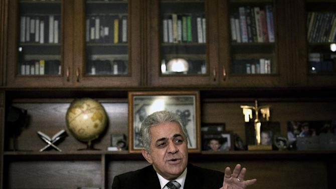 Egyptian opposition leader Hamdeen Sabahi talks during an interview with the Associated Press at his office in Cairo, Egypt, Monday, Dec. 24, 2012. Sabahi said there will be continued resistance to the constitution even though it passed, contending that the majority of Egyptians are not Islamists. (AP Photo/Nasser Nasser)