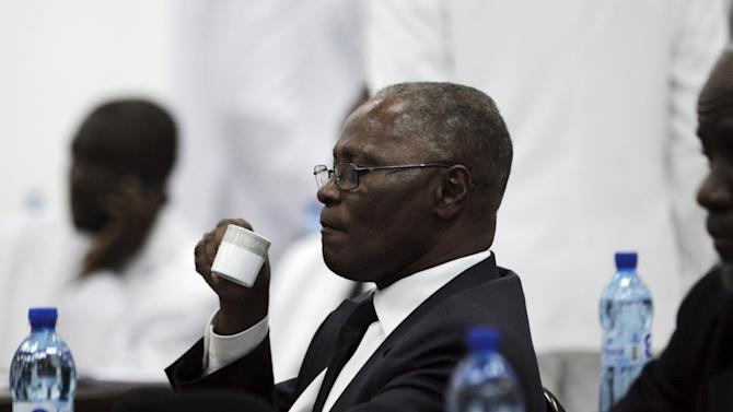 Provisional president candidate Jocelerme Privert drinks coffee during the Special Bicameral Commission for the election of the provisional President of the Republic in the Haitian Parliament in Port-au-Prince, Haiti