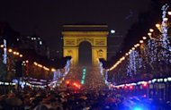 People gather on the Champs-Elysees in Paris to celebrate the New Year, on December 31, 2012. World cities from Sydney and Hong Kong to Dubai and London rang in the New Year with spectacular fireworks, as revelers at Times Square in New York sought to top off the global extravaganza.