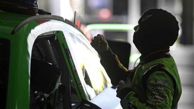 Danica Patrick prepares to climb into her car during practice for Sunday's NASCAR Sprint Cup series Coca-Cola 600 auto race at Charlotte Motor Speedway in Concord, N.C., Thursday, May 23, 2013. (AP Photo/Nell Redmond)
